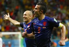 van Persie of the Netherlands celebrates with teammate Robben after scoring the team's fourth goal against Spain during their 2014 World Cup. Spain Vs Netherlands, Netherlands World Cup, Fifa Football, World Football, Football Players, World Cup 2014, Fifa World Cup, World Cup Groups, Jamaica News