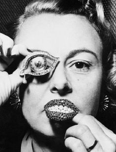 """Jewelry art by Salvador Dali: """"Eye of Time"""" and """"ruby lips"""" brooches. The compositions of the 1950s."""