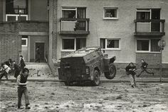 Don McCullin   Riots in Northern Ireland. Don McCullin simultaneously dodges a British Army Humber 'Pig' and the missiles being thrown by rioters in the Bogside, Londonderry.   1971