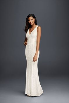 Simply stunning, DB Studio's lace sheath wedding dress features a V-neckline and V-back edged in scalloped lace. Exclusively at David's Bridal.