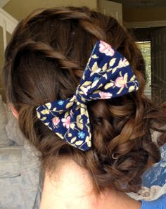 3 braids into a braided bun. <3 the bow