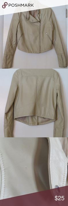 "American Eagle Pleather Beige Moto Jacket Small * American Eagle *  Cute beige moto jacket. Fully lined. Gently used in very good condition. There are a couple pin holes.  You have to look close to see them.  Size:  Small Underarm to underarm: 36"" around Total Length: 21""  *All of my items are from a clean, smoke free home. American Eagle Outfitters Jackets & Coats"