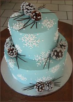Blue snowflake  and frosty pine cone cake for a #Christmas or #Winter #wedding.