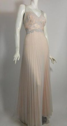 1950s powder pink nylon Vanity Fair nightgown with soft smoky blue chiffon overlay. Pink nylon is pleated from waist down, blue lace overlay on bodice, blue chiffon gathered straps. Deep V back. Via Dorothea's Closet Vintage.