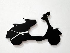 Hey, I found this really awesome Etsy listing at https://www.etsy.com/listing/191716934/vespa-scooter-wall-clock