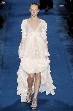 9. Yves Saint Laurent Fall 2005. Belting under breasts, sheer dress, and detail on sleeve like the 1790s. Empire Period