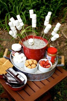 GREAT idea for beach parties!!! Super smores, put a bag over the marshmallows so bugs won't get on them.