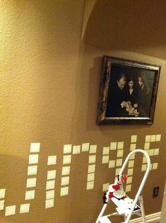Elf on the shelf got a little crazy with the sticky notes....spelled his name on the wall