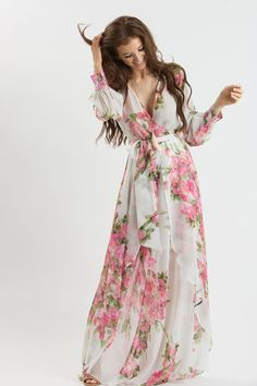 We've got a major obsession with lightweight chiffon maxi dresses! This pretty printed dress is so comfortable you'll want to wear it all year long! Dress this piece up with a statement necklace and s