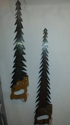Check out this item in my Etsy shop https://www.etsy.com/listing/265456488/repurposed-hand-saw-tree