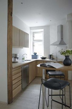 Natural wood finish compact kitchen
