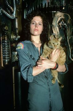 Lt. Ellen Ripley (with Jonesy) of the Alien Series. I choose you to be on my any-kind of apocalypse team!