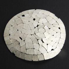 "Pin, ""Cracked Up"", 18k Gold, Sterling Silver       Artist    John Iversen"
