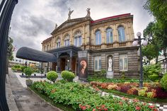 A wide angle look at the Teatro Nacional in San José Costa Rica!  I wanted to get a view of the building without its surrounding fence so sneaked my camera between the bars and got this cool view I hope you will enjoy!