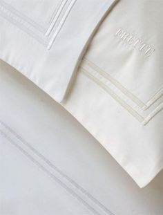 Frette Classic Double Piping Hotel Bedding:  Made of 100% Egyptian cotton in a luxurious 200 thread count.  Available in white with white piping.