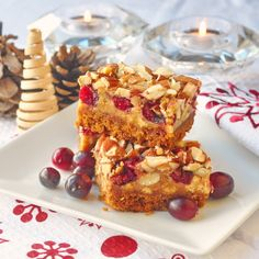 Cranberry White Chocolate Magic Bars - maybe the easiest cookie bars ever! Just layer 4 ingredients on a graham crumb base and bake. The tart pop of the cranberries is perfect with the sweet white chocolate and crunchy almonds.