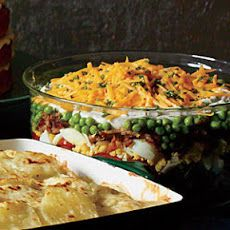 Make-Ahead Layered Salad.  feeds a large crowd and is very tasty.  can make in AM to serve in PM