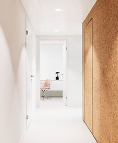 Cork wall cladding with hidden door at Heart Surgery Zurich by Dost