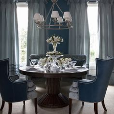 Holiday decorating ideas: Blue dining room with Christmas crystal. A low-hung ceiling light adds to a sense of intimacy, while a sparkling crystal centerpiece introduces a touch of luxury.
