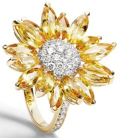 Asprey Daisy Heritage Ring, Yellow Sapphire. Revisiting the house's archives, Asprey jewellery designers have modified some of the most cherished Daisy Collection classics to create new editions of iconic favourites. Created by the Asprey craftsmen, the Daisy Heritage Ring, has been individually set with marquise cut yellow sapphire petals and a pavé diamond centre, all set in 18ct yellow gold.