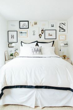 Black and white bedroom with gallery wall surrounding headboard