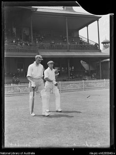 Alan Fairfax and Don Bradman walking onto a cricket field, in Sydney, New South Wales, ca. 1931.  v@e.