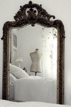 Antique mirror and mannequin