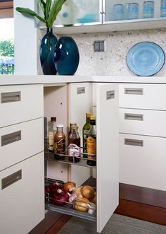 Pullout wire drawers make the most of the storage space inside a cabinet that houses smaller items, which can easily become lost in the recesses of a deep cabinet.