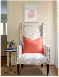 Love this punch of coral and adore the lines of this chair!