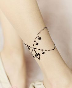 Pretty anklet tattoo