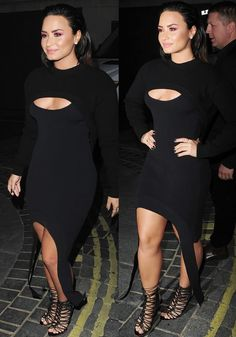 The pop star wore a low cut dress with a yoke cardigan to create a cutout illusion