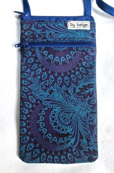shweshwe zipped cell phone neck holder with zipped front pocket.