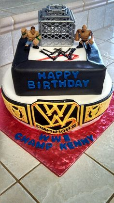 WWE cake for a friends son third birthday. The Rock and John Cena wwe brawlers cage match