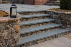 Pennsylvania bluestone treads are placed over Tennessee dry stack fieldstone for these patio steps. The wall and wall caps also are made of Tennessee fieldstone selected by Atlanta-based King Landscaping. Backyard Door, Patio Stairs, Exterior Stairs, Ideas Estanque, Yard Ideas, Patio Ideas, Outdoor Stone Steps, Outside Steps, Front Porch Steps