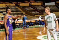 Larry Bird and Magic Johnson joke around during pregame warmups before a 1988 Celtics-Lakers game at Boston Garden. (Steve Lipofsky/Corbis)