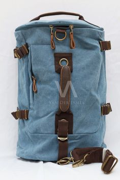 4 in 1 Style: Handbag, Shoulder bag, Messenger Bag, Arm Bag, Backpack Material: Cow Leather & High Quality Canvas Dimension: P: 30cm, T: 50cm, L: 25cm Processing Surface: Soft Surface Color: Blue Structure: Zipper pockets, cell phone bags, document bags, laptop pocket Applicable gender: Male & Female.