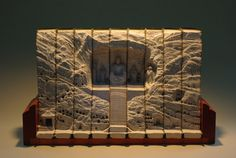 "These ""carved book landscapes"" are amazing. http://www.thisiscolossal.com/wp-content/uploads/2011/12/guy-5.jpg"