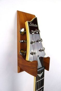 Hey, I found this really awesome Etsy listing at https://www.etsy.com/listing/270739757/jatoba-wall-mounted-guitar-hanger