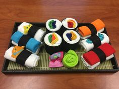Here's a spin on a traditional diaper cake- a diaper sushi tray! Made from diapers, wash clothes, baby socks and bath toys. Super fun!