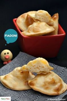 Fiadoni - a typical Easter dish from Abruzzo, in Central Italy. Savoury ravioli, filled with cheese and then baked until golden brown.