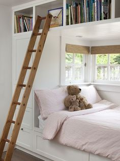 Contemporary kids' room with alcove bed featuring built-in storage and a ladder