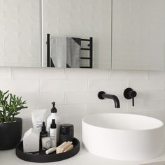 Black and white bathroom styling featuring black concrete tray from Zakkia, ASPAR spa products and Nocturna black candle