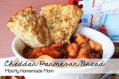 Cheddar Parmesan Bread - Bisquick, cheddar, parmesan, oregano, milk, eggs, butter - your house will smell SO yummy!! www.mostlyhomemademom.com