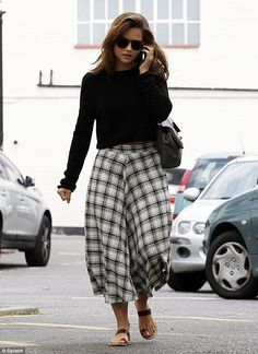 Check her out: Jenna Coleman looks lovely in a patterned skirt as she run errands in North London on Wednesday