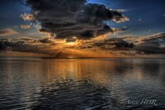 This is a handheld HDR capture of a sunrise in the Keys, I am near Marathon Florida. Work Flow Three raw images imported into Photomatix Pro from Adobe Bridge Tonemapped image imported into Photoshop Elements 11 Topaz Denoise and High Passed Sharpened From Photoshop Elements 11 I selected Automate Tools …