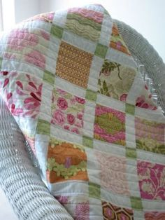 Charm Square Quilt: so simple, so pretty - these fabrics make it appear vintage
