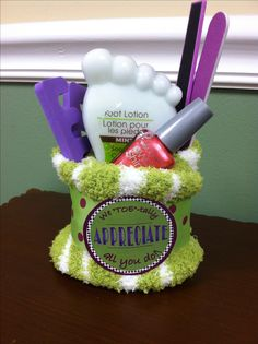 """We TOE-tally appreciate all you do!"" Made 15 of these for volunteer appreciation gifts but forgot to photograph them. Color scheme of others was much better, all shades of lime and plum. This was a leftover...included fuzzy socks, nail polish, foot scrub, pedicure kit items. Total $4 each."