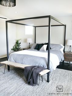 Get a clean and modern look for your bedroom with this Modern Steel Canopy Bed with gray bedding from Room & Board