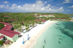 Experience a true #caribbean paradise with white sand #beaches met by translucent turquoise water. The #beachresort features colorful accommodations nestled amidst lush flowering gardens and the sea.