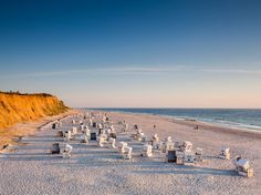 Enormously wide beaches, endless sand dunes, wide open countryside, and charming villages draw summertime visitors to these islands facing the North Seas on the border with Denmark. Lesser-known Amrum has Europe